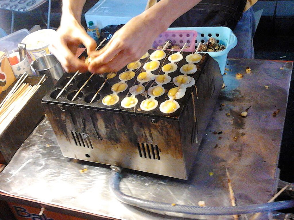 Fried eggs on a stick in Malaysia, Asia's Melting Pot