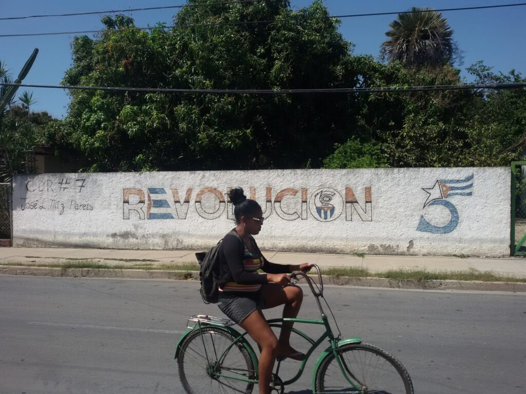 Woman riding a bike in Cienfuegos on Cuba