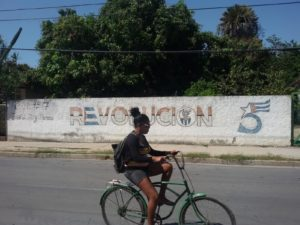 Woman riding a bike in Cienfuegos on Cuba