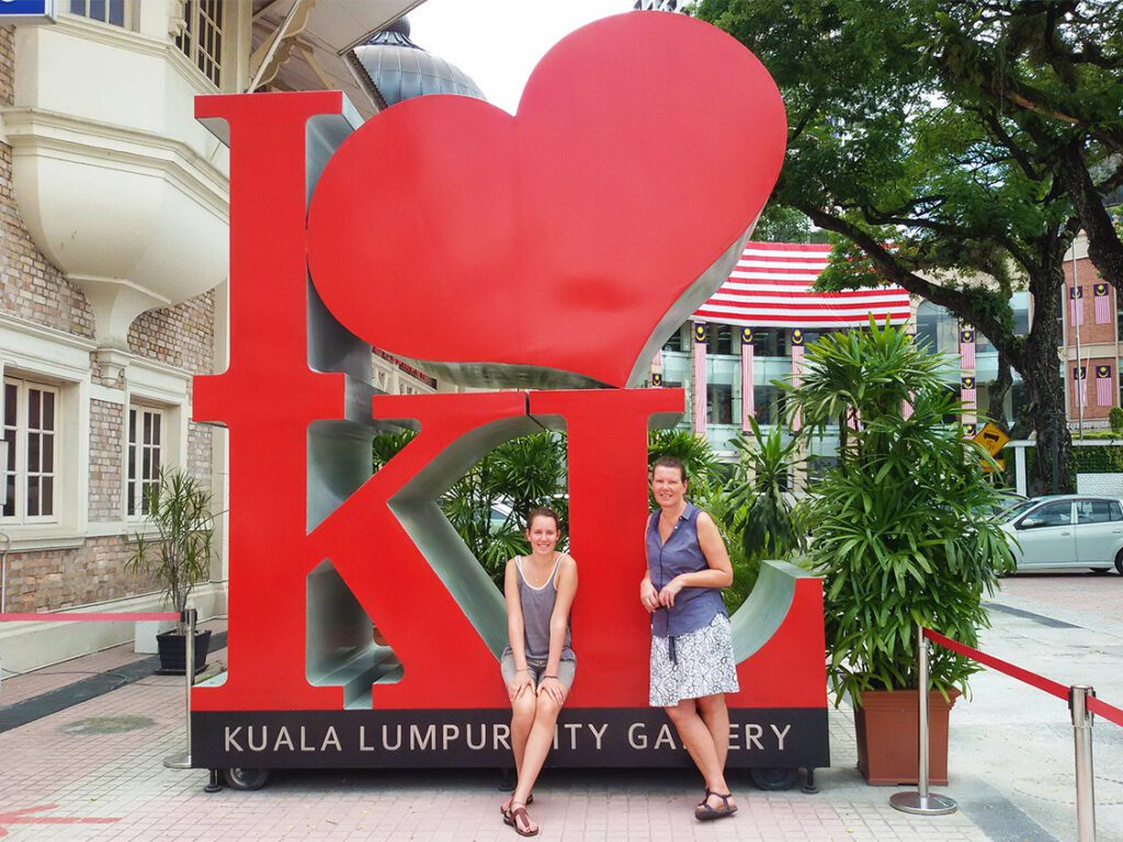 Renata Green and Mimi at the I love KL sign