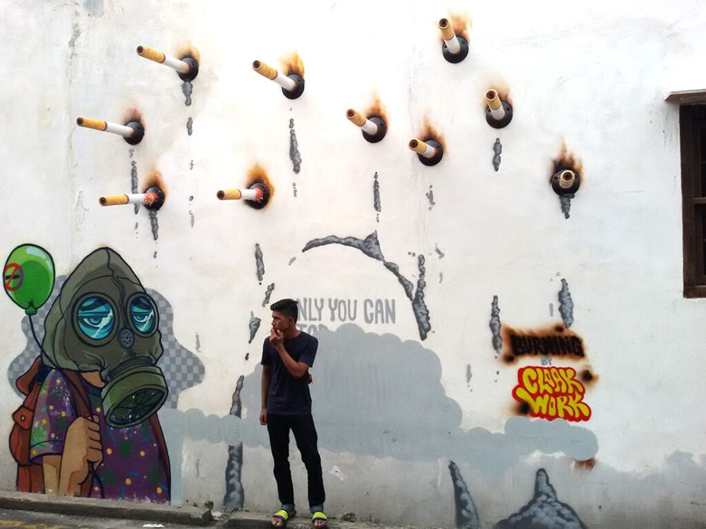 Graffiti artist and illustrator Cloakwork from Kuala Lumpur created the mural Only You Can Stop Air Pollution on Ah Quee Street