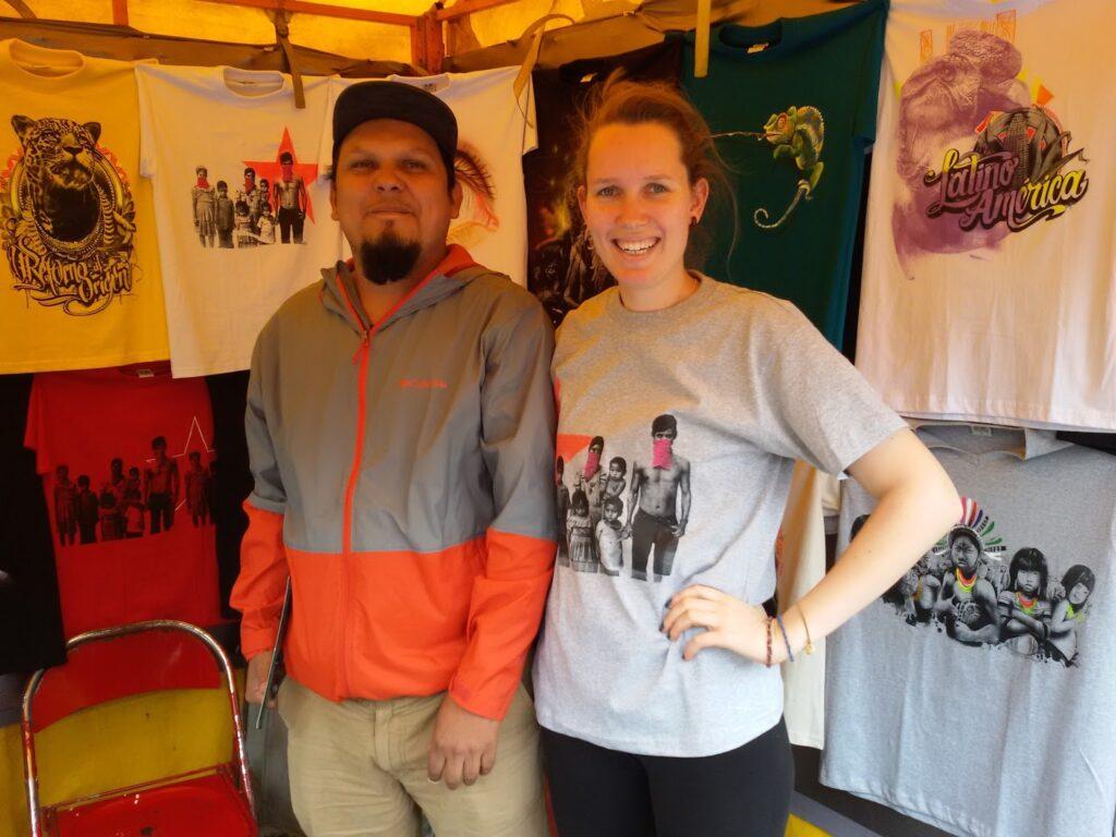 Mimi with Carlos Trilleras in a shirt made by Carlos Trilleras at Carlos Trilleras' stand #302 at Mercado de Pulgas San Alejos.