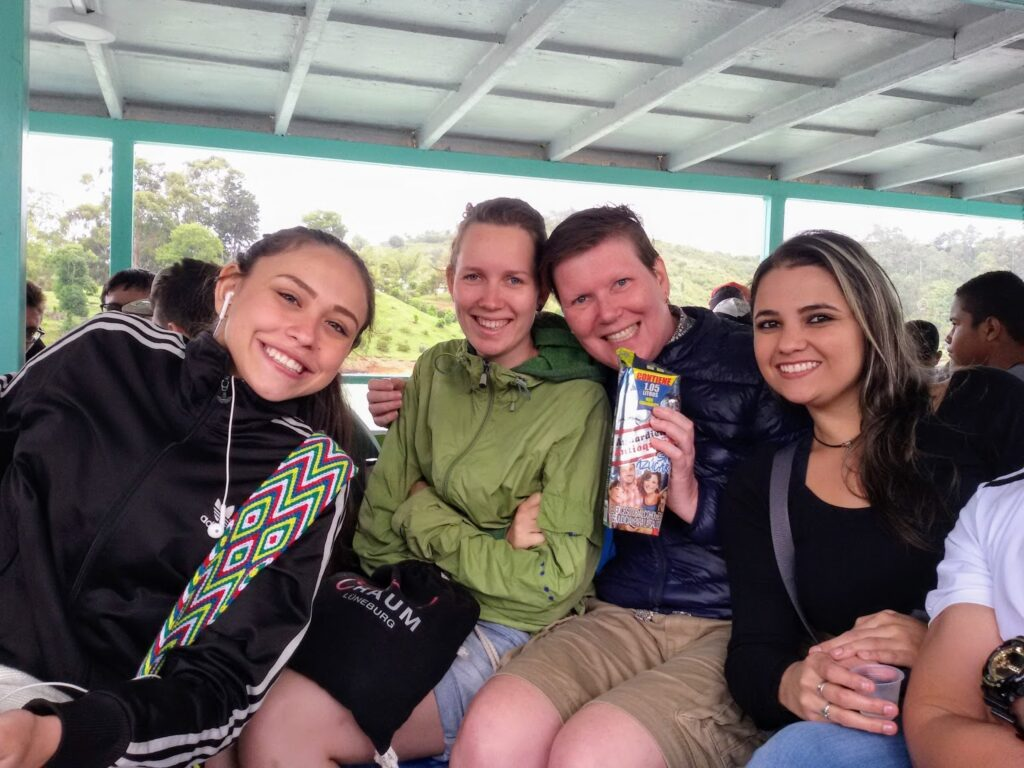 People drinking Aguardiente on a boat in Colombia.