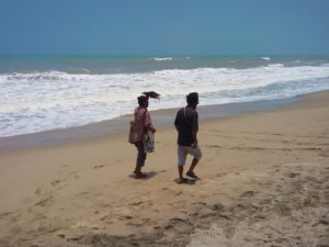 Two men walking on the beach of Palomino, Colombia
