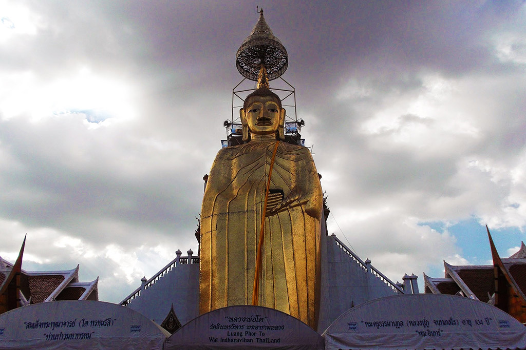 Buddha at Wat Indrawiharn in Bangkok when staying more than just one night.
