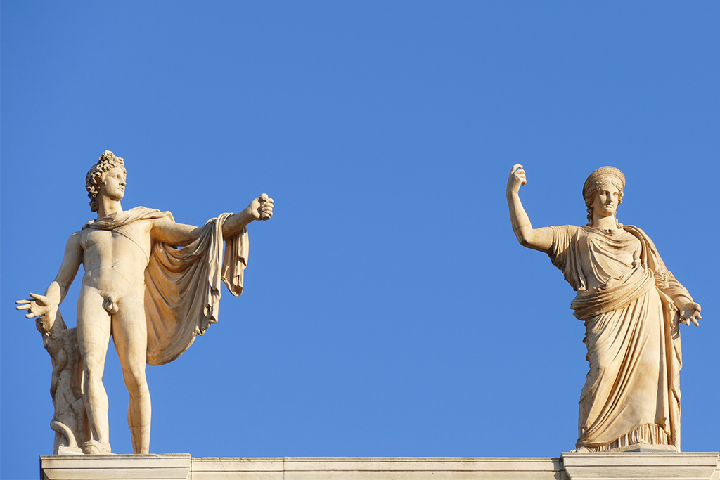 Statues of Apollo and Hera on the roof of the Archaeological Museum in Athens