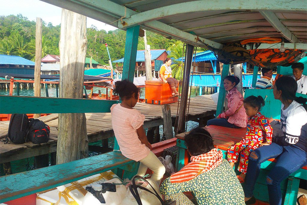 People on a small boat at Koh Rong, Cambodia
