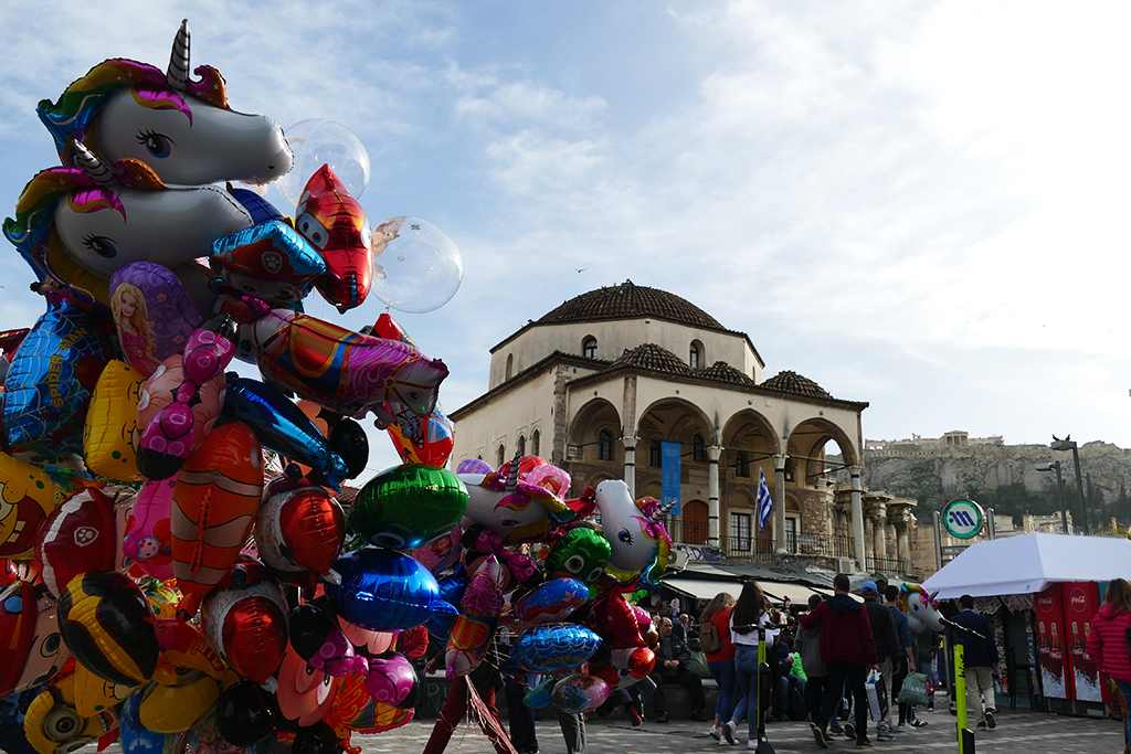 Balloon seller in front of the Tzistarakis Mosque