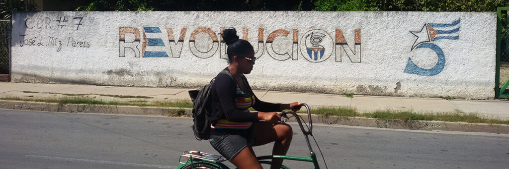 woman cycling cienfuegos on cuba