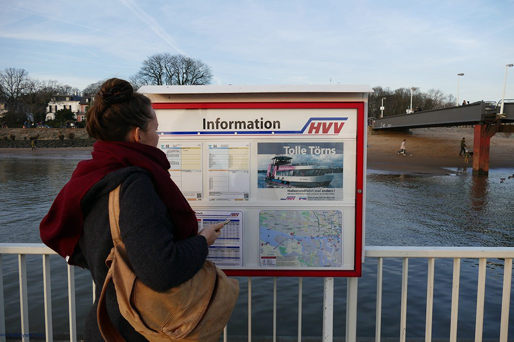 Woman checking the timetable of ferry 62 in Hamburg