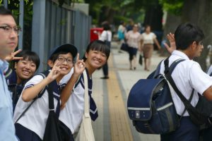 School kids in Tokyo, Japan greeting first-timers.