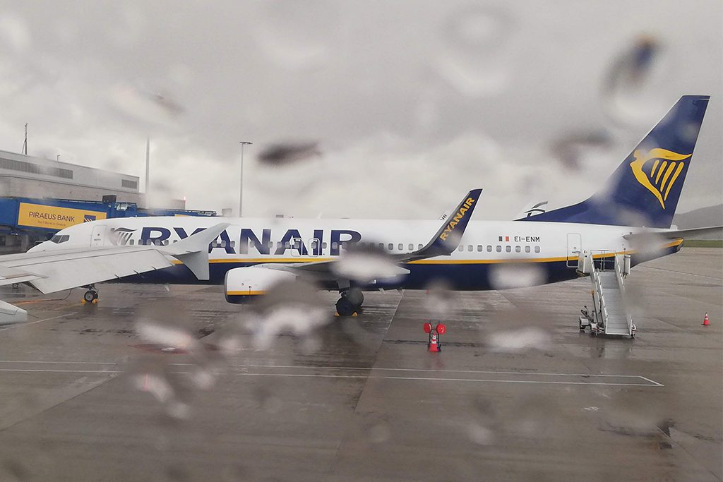A Ryanair Plane seen through the rain.