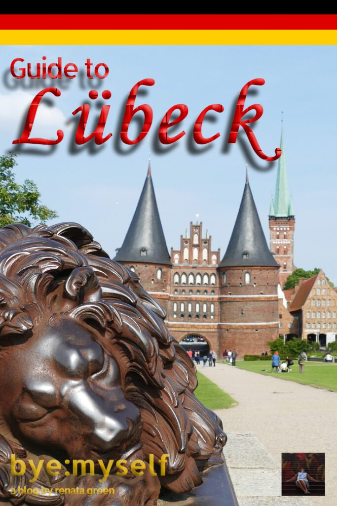 Pinnable Picture for the post on Lübeck showing a lion and the Hanse Gate
