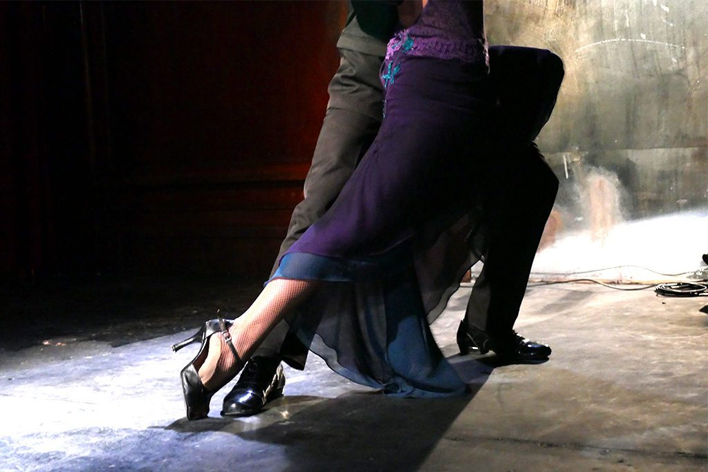 Couple dancing Tango at the Cafe Tortoni in Buenos Aires, Argentina