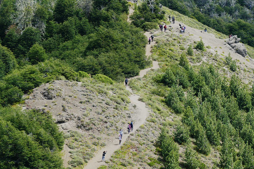 People hiking down Cerro Otto in Bariloche