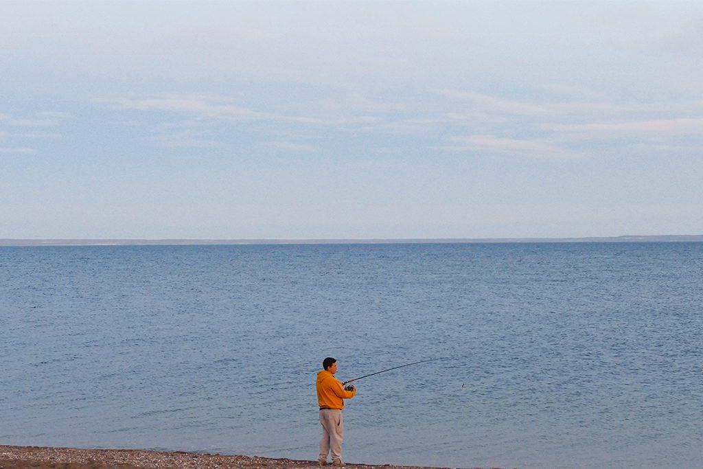 A man fishing at the Buenos Aires Lake in Los Antiguos