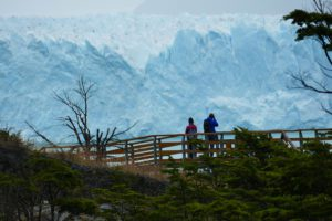 Couple taking pictures of the Perito Moreno Glacier close to El Calafate in Patagonia, Argentina