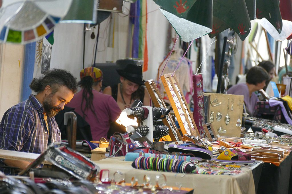 Local artists handcrafting original pieces at the Paseo Resistencia