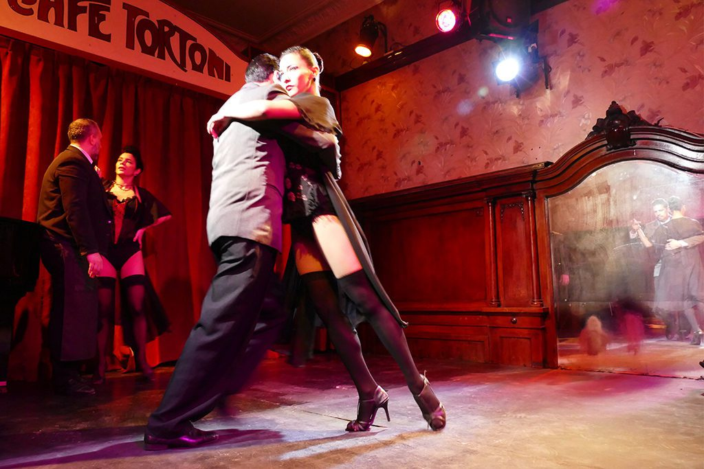 People dancing Tango at the Cafe Tortoni in Buenos Aires