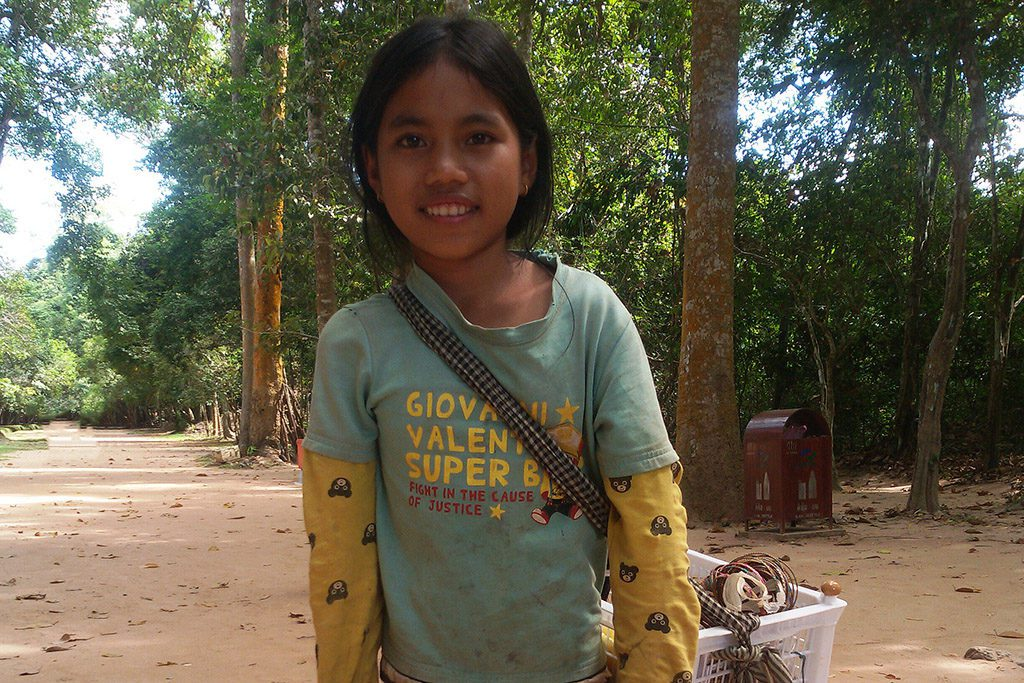 One of many little girls selling souvenirs at Preah Kahn