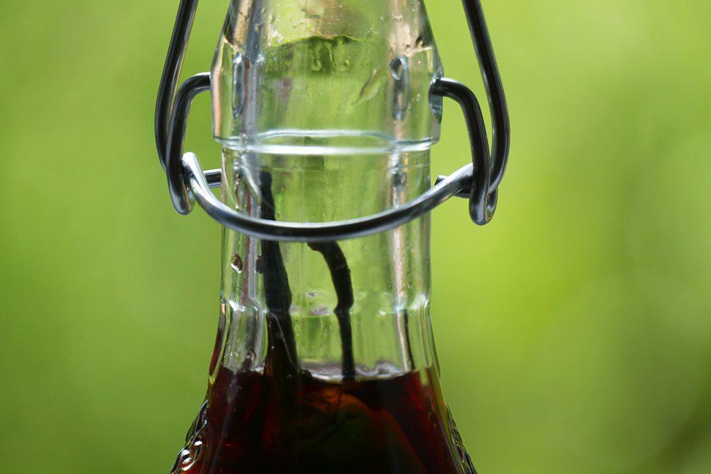 Bottle of pickled pepper wine