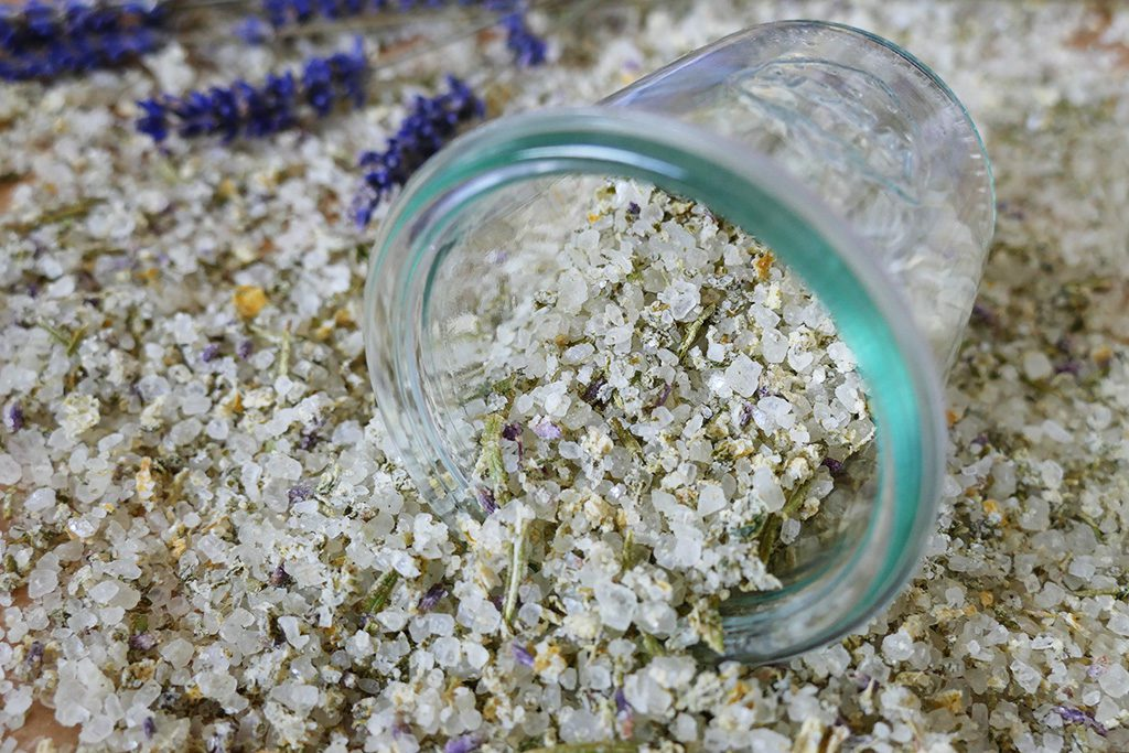 Homemade Salt with Herbes de Provence, potted in a glass jar.