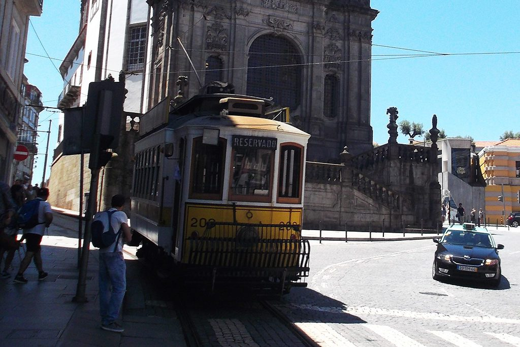 The tram with the iconic Igreja dos Clérigos in the backdrop.