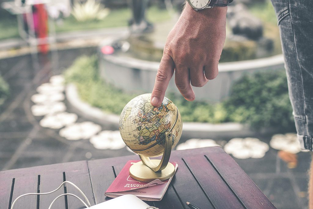 Finger turning a mini globe