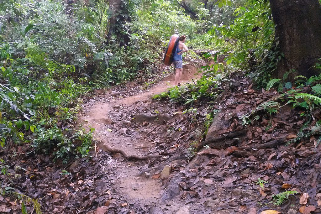Woman carrying a tire in the rainforest in Palomino, Colombia