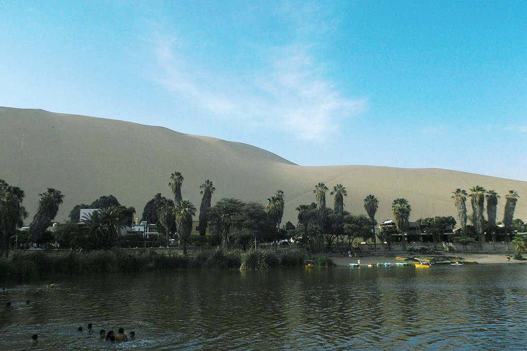 People Frolicking in the lagoon of Huacachina.