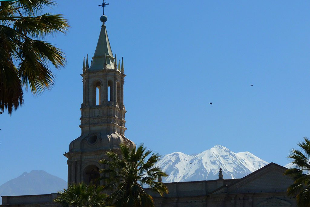 View of one of the Cathedral's towers and the volcanoes Misti and the snow-covered Chachani, introduced in the guide to Arequipa and the Colca Canyon.