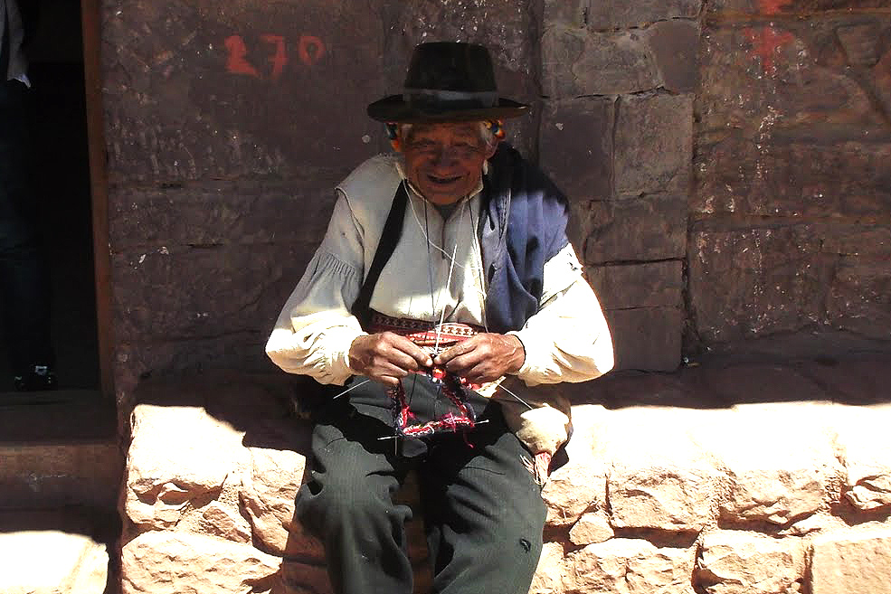 A man knitting on Isla Taquile, visited on a day trip from Puno to the Uros Islands on Lake Titicaca.