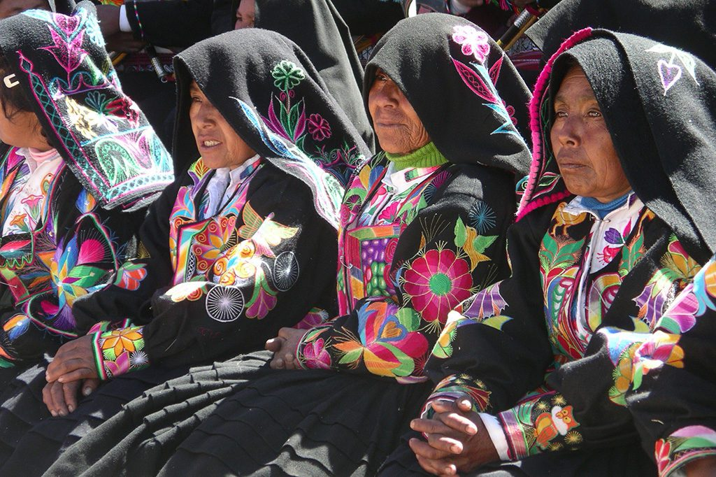 Women on Isla Taquile on Lake Titicaca after visiting the Uros Islands on a trip from PUNO