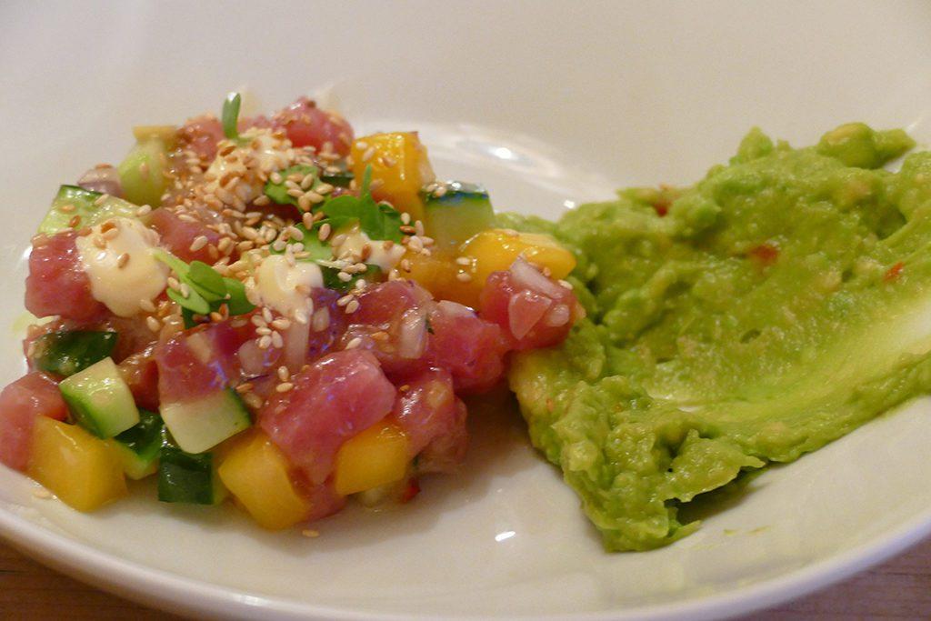 Tuna-mango-tartar with avocado cream for a starter.