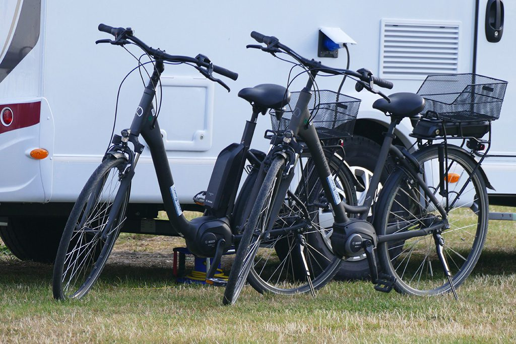 E-Bikes in Front of a Van on Fehmarn