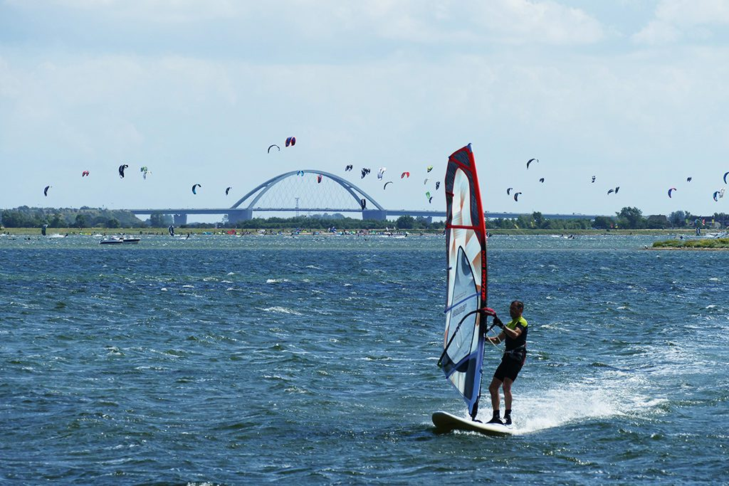 Surfer in front of the Fehmarnsoundbridge off the Island of Fehmarn