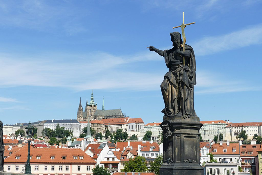 Statue John the Baptist on the Charles Bridge in Prague
