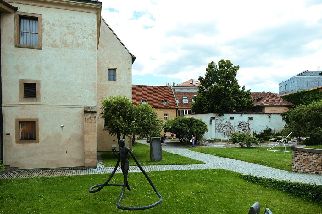 Anežský_klášter in Prague with modern sculptures in the garden.