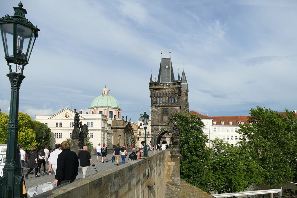 Crossing the Charles Bridge towards the historic old town.