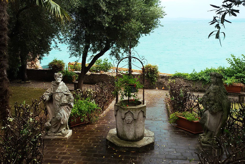 Il Pozzo, Well with Statues in Sirmione with Lake Garda in the Backdrop