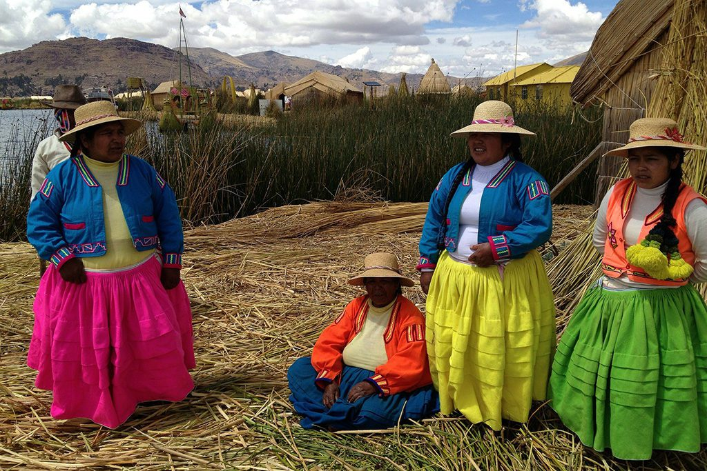 On an Uros islands on Lake Titicaca on a trip from PUNO to the Taquile island
