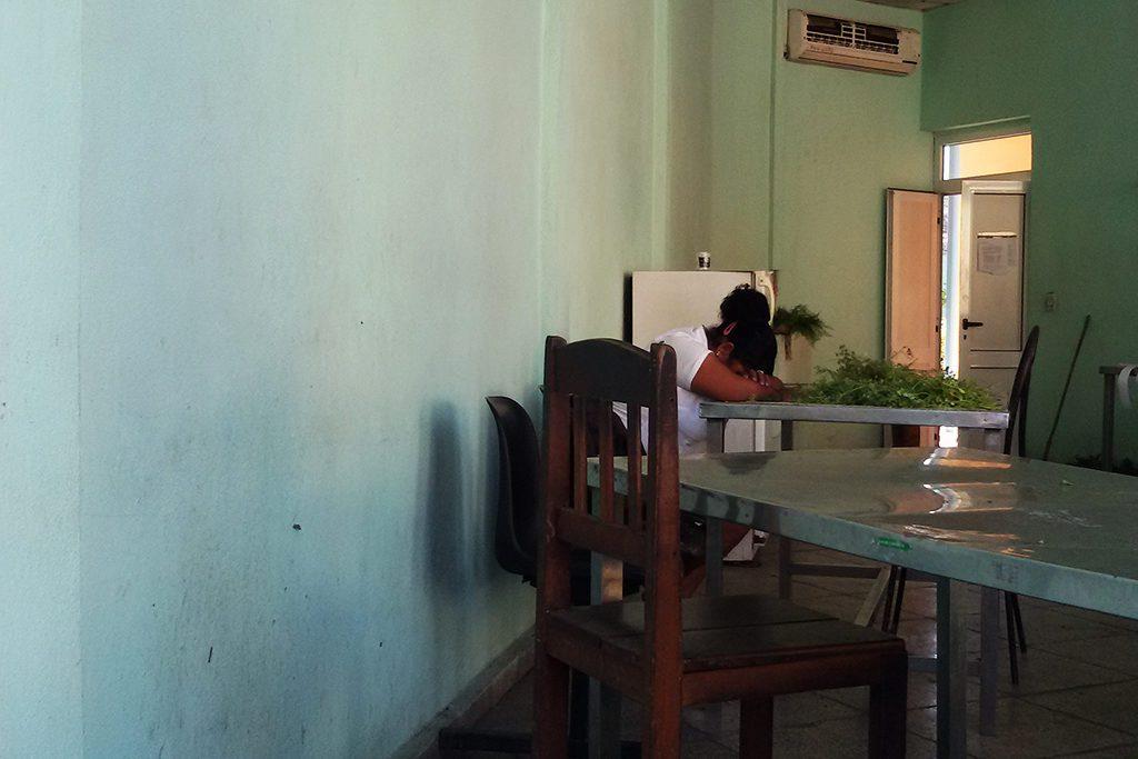 Woman sleeping on a table in Santiago de Cuba