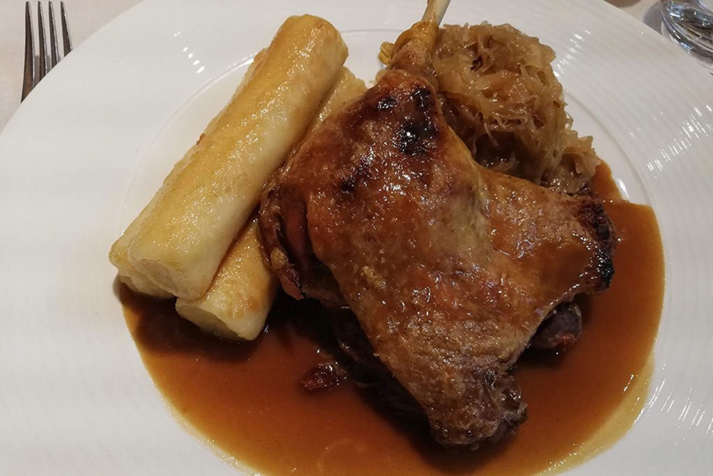 Duck with glazed potato dumplings.
