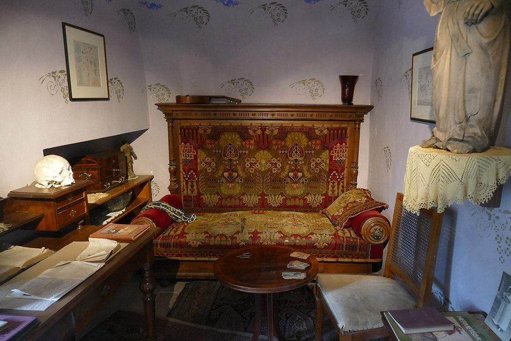 Tiny parlor of Madame de Thebes.