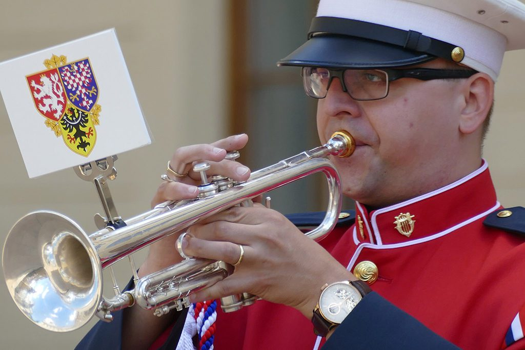 Soldier playing the trumpet on the Hradčany Square in Prague