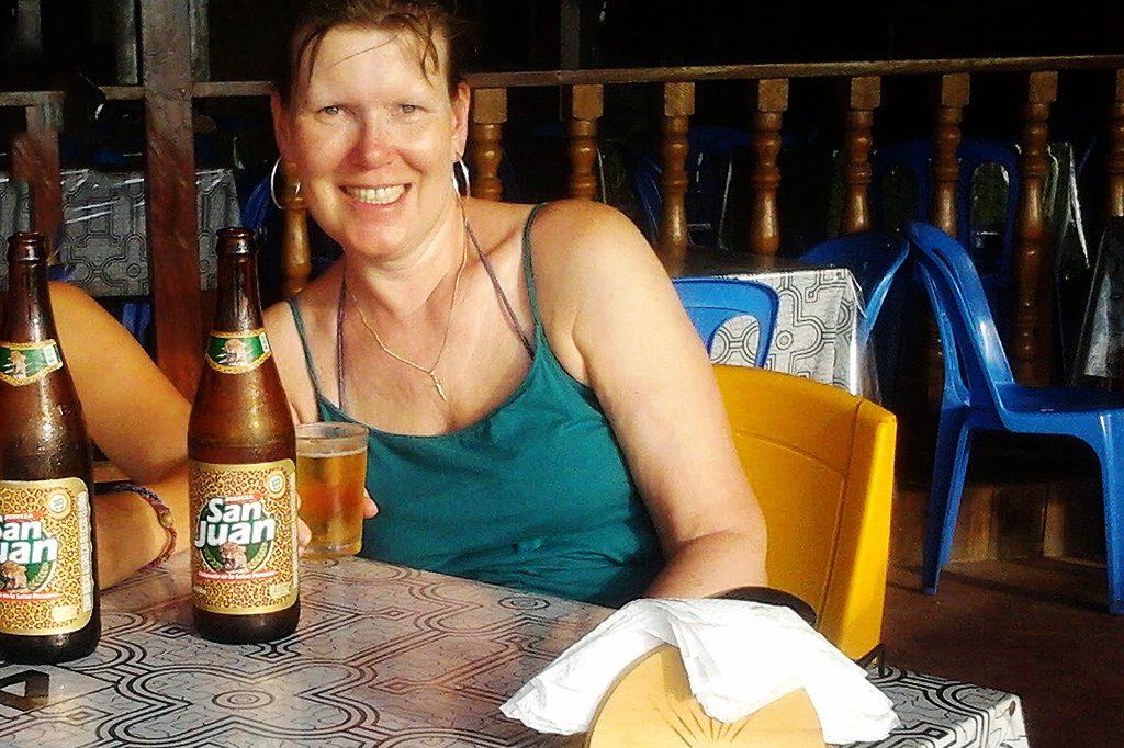 Renata Green drinking beer at the  Yarinacocha Lagoon