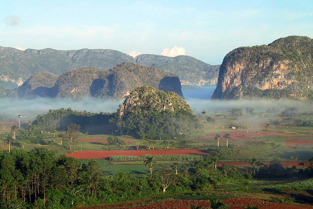 Mogotes in the mist in Vinales, Cuba 's Rural Paradise