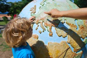 Child with a Globe illustrating Amazing Opportunities: It's never too late to become an Au Pair