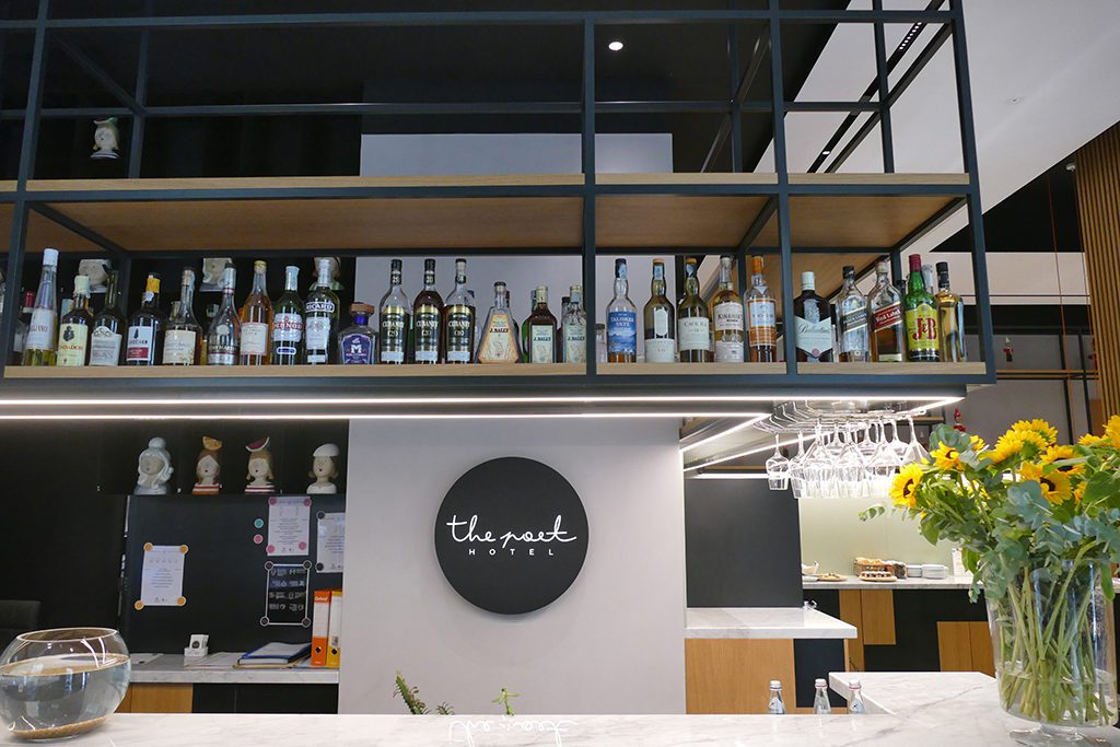 The reception and the bar are one at The Poet Hotel in La Spezia, the gateway to the Cinque Terre.