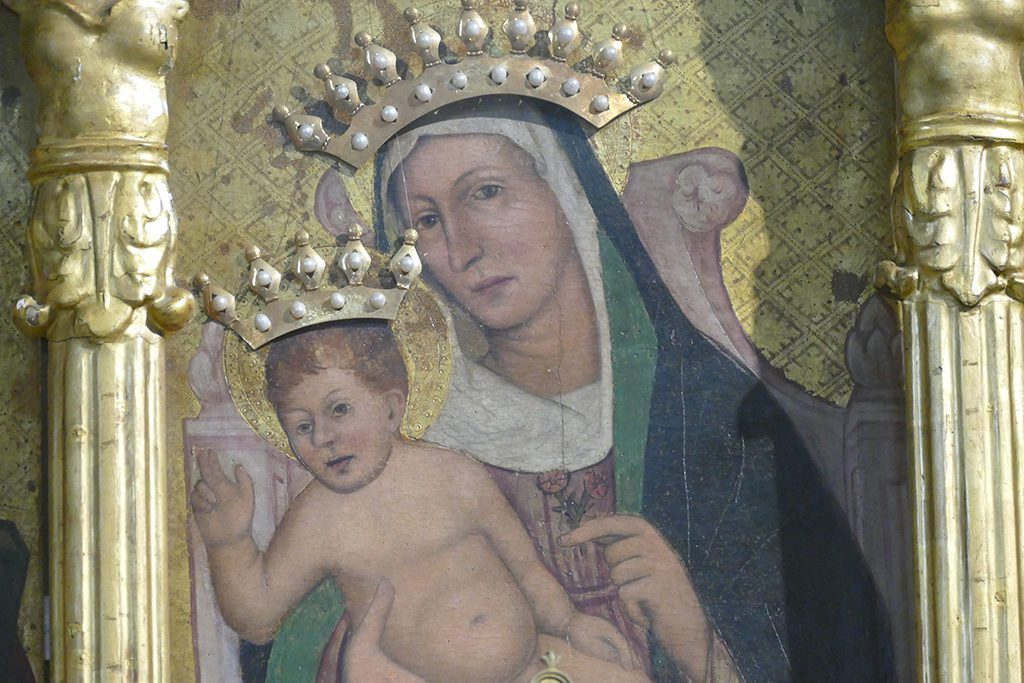 The Madonna with Child from the central triptych of the Oratorio di Nostra Signora Assunta in Cielo .
